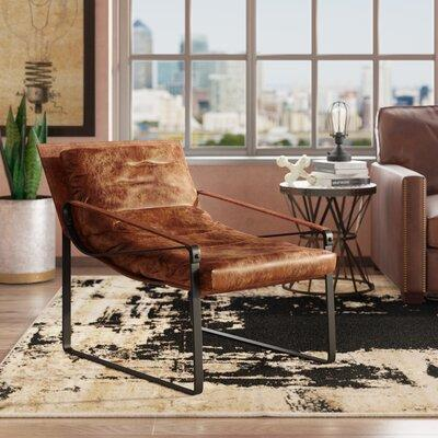 17 Stories Kassy Lounge Chair STSS5787 17 Stories Bring home beautiful accent Kassy Top Grain Leather Lounge Chair made of top grain leather. Tucked in the corner of the living room, sidled up next to a side table, or centered on an enclosed porch,...